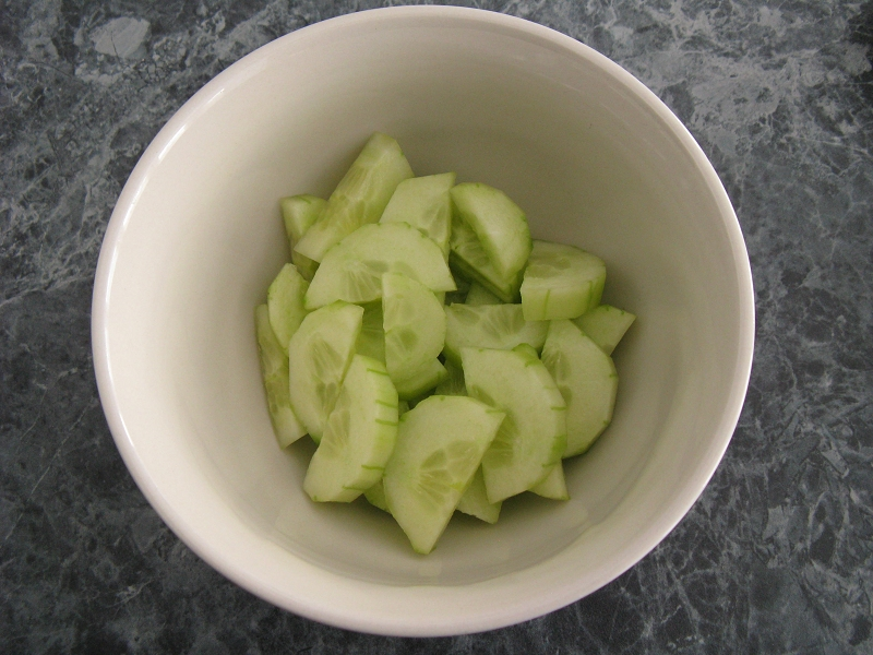 Cucumber diced in bowl