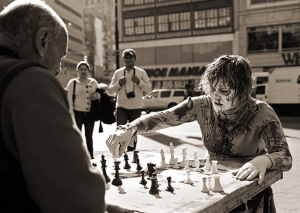 Zombie playing chess [Photo Credit: Unknown]