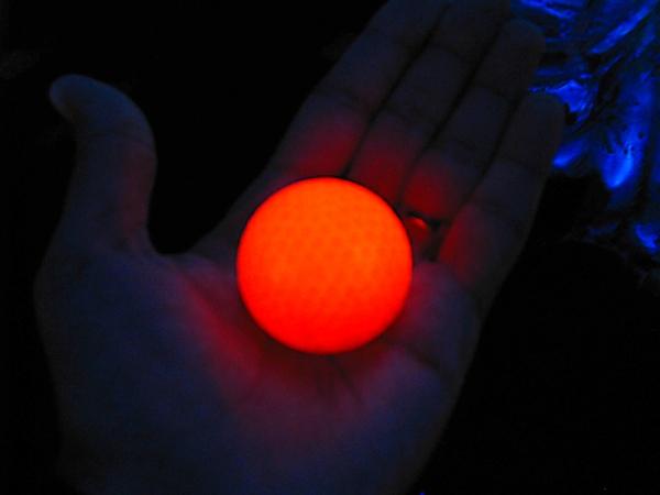 Glow in the dark golf ball in my hand