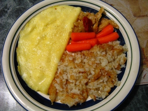Omelet with hash browns, carrots and marinated eggplant